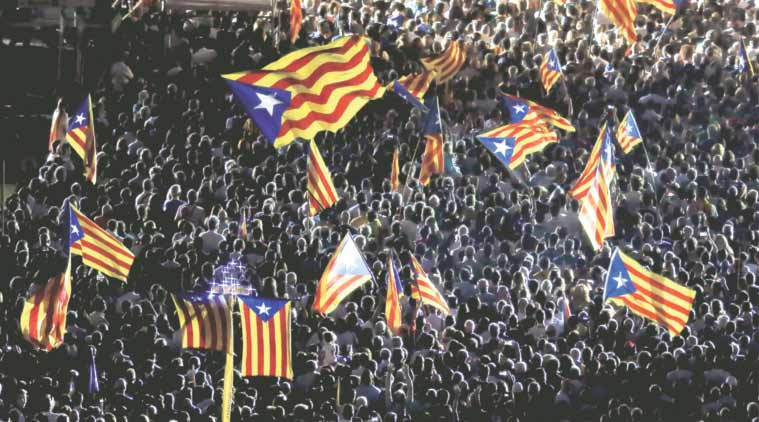 Catalan separatist flags fly during the last meeting of the Catalan pro-independence party Junts pel Si in Barcelona over the weekend. (Source: Reuters)