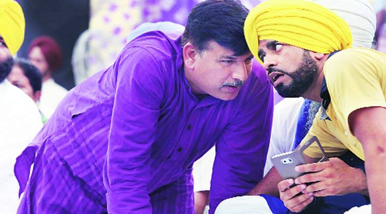 AAP Punjab in-charge Sanjay Singh (left) talks to a leader during the rally in Ludhiana.   Gurmeet Singh
