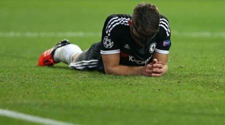 Chelsea's Gary Cahill lies on the pitch at the end of the Champions League group G soccer match between FC Porto and Chelsea FC at the Dragao stadium in Porto, Portugal, Tuesday, Sept. 29, 2015. Porto won 2-1. (AP Photo/Steven Governo)