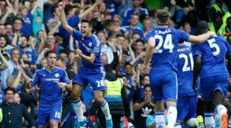 Chelsea's Eden Hazard, left ,celebrates with teammate Chelsea's Cesar Azpilicueta, centre, after scoring his sides second goal during the English Premier League soccer match between Chelsea and Arsenal at Stamford Bridge stadium in London, Saturday, Sept. 19 2015. Chelsea won 2-0.(AP Photo/Alastair Grant)