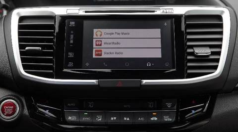 Apple, Google drive smartphone functions into car dashboards