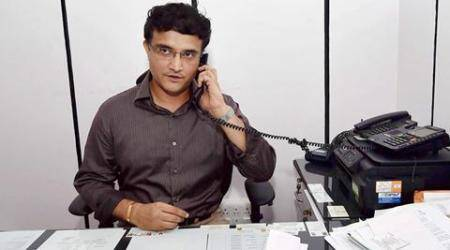 Kolkata: Former Indian Captain Sourav Ganguly talks over phone at his chamber at Cricket Association of Bengal after his name was announced as CAB President in Kolkata on Thursday. PTI Photo by Swapan Mahapatra(PTI9_24_2015_000263A)