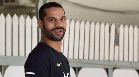 Bengaluru : Shikhar Dhawan arrives to take part in a seven days preparatory camp for the upcoming series against South Africa at National Cricket Academy in Bengaluru on Tuesday. PTI Photo by Shailendra Bhojak   (PTI9_22_2015_000065A) *** Local Caption ***