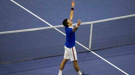 Novak Djokovic of Serbia celebrates after defeating Roger Federer of Switzerland in their men's singles final match at the U.S. Open Championships tennis tournament in New York, September 13, 2015.    REUTERS/Carlo Allegri
