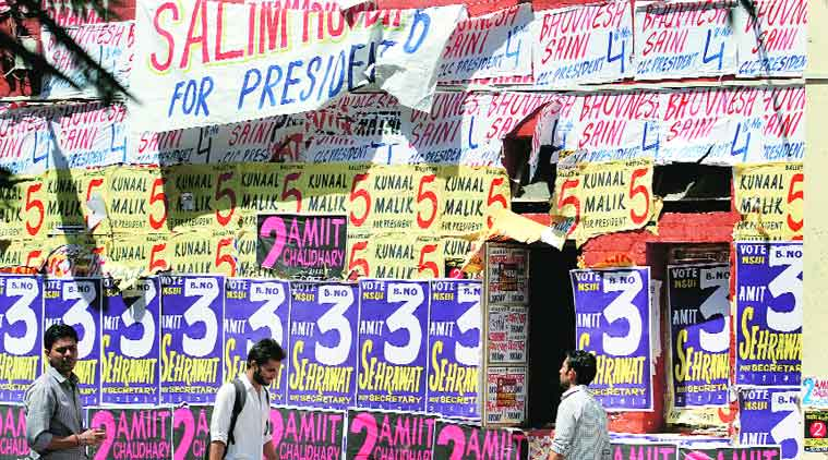 Students walk past a glut of posters at Faculty of Law, North Campus. (Source: Express photo by Ravi Kanojia)