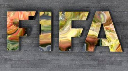 The FIFA logo is fixed on a wall of the FIFA headquarters during a meeting of the FIFA Executive Committee in Zurich, Switzerland, Friday, Sept. 25, 2015. FIFA canceled a news conference scheduled with President Sepp Blatter without explanation, fueling the sense of turmoil surrounding football's embattled governing body. (AP Photo/Michael Probst)