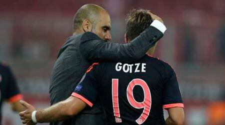 Bayern's head coach Pep Guardiola congratulates Mario Goetze after winning 3-0 during the Champions League Group F soccer match between Olympiakos and Bayern Munich at Georgios Karaiskakis stadium in Piraeus port, near Athens, Wednesday, Sept. 16, 2015. (AP Photo/Thanassis Stavrakis)