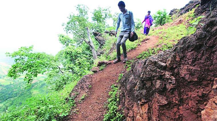 Teachers Dilip Chaudhary and Ramila Vasava trek to teach at a school. Bhupendra Rana