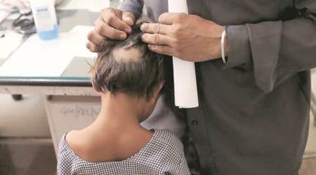Six-year-old's father accuses teacher of pullinghair