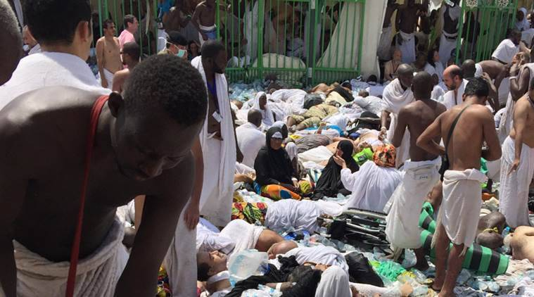 Muslim pilgrims gather around the victims of a stampede in Mina, Saudi Arabia during the annual hajj pilgrimage on Thursday. (Source: AP photo)