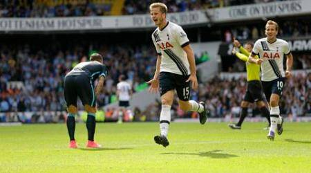 Tottenham Hotspur's Eric Dier, center, celebrates scoring his side's first goal beside Harry Kane, right, during the English Premier League soccer match between Tottenham Hotspur and Manchester City at White Hart Lane stadium in London, Saturday, Sept. 26, 2015.  (AP Photo/Matt Dunham)