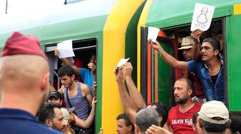 After two-day blockade Hungary opens door to trains for migrants, but only to camps
