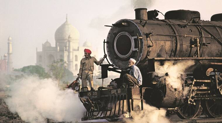 A train passes by the Taj Mahal