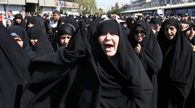 """Iranian worshippers chant slogans while attending an anti-Saudi protest rally on Thursday, after their Friday prayer service in Tehran, Iran, Friday, Sept. 25, 2015. Thousands of Iranian worshippers have marched in Tehran after Friday prayers to denounce the """"incompetency"""" of Saudi Arabia in handling the annual hajj pilgrimage. The protest came a day after at least 719 pilgrims died during a crush on the outskirts of the holy city of Mecca. (Source: AP Photo)"""