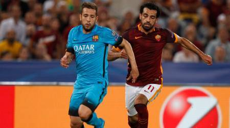 Roma's Mohamed Salah, right, and Barcelona's Jordi Alba run for the ball  during a Champions League, Group E soccer match between Roma and Barcelona, at Rome's Olympic stadium Wednesday, Sept. 16, 2015. (AP Photo/Riccardo De Luca)