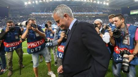 Photographers swarm Chelsea manager Jose Mourinho on the sidelines during the Champions League group G soccer match between FC Porto and Chelsea FC at the Dragao stadium in Porto, Portugal, Tuesday, Sept. 29, 2015.  Porto won 2-1. (AP Photo/Steven Governo)