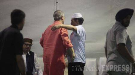 Delhi CM Arvind Kejriwal and L-G Najeeb Jung share a hug. Express Photo