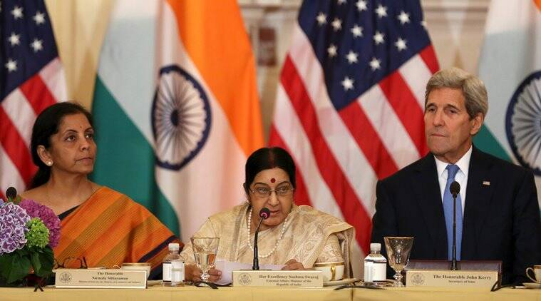 U.S. Secretary of State John Kerry (R) listens to India's Minister of Commerce and Industry Nirmala Sitharaman (L) and External Affairs Minister Sushma Swaraj (C) at the U.S-India Strategic & Commercial Dialogue plenary session at the State Department in Washington September 22, 2015.   REUTERS/Gary Cameron