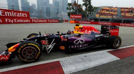Redbull driver Daniil Kvyat, of Russia, steers his car during the first practice session at the Singapore Formula One Grand Prix on the Marina Bay City Circuit in Singapore, Friday, Sept. 18, 2015.(AP Photo/Ng Han Guan)