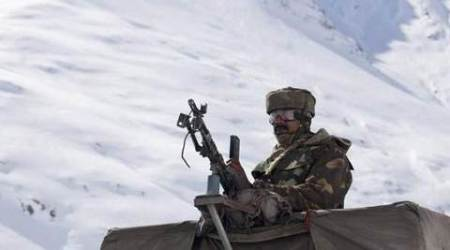 An Indian Army soldier stands in an armored vehicle during the re-opening ceremony of the Zojila Pass, 110 kilometres (68 miles) north of Srinagar, India, on 6 April 2013. The Srinagar-Leh National Highway connecting Ladakh to the Kashmir Valley was re-opened to traffic Saturday after remaining closed for nearly six months. The highway passes through the 3,510 metre-high Zojila pass which lies on the lower depressions of the Himalayan range.