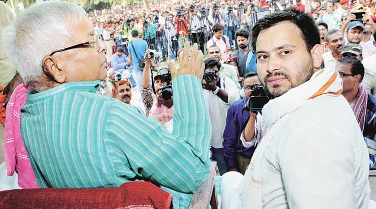 RJD chief Lalu Prasad with his son and Raghopur candidate Tejashwi Yadav during the first day of the campaign at Terasiya village, Sunday. (Express Photo by: Prashant Ravi)