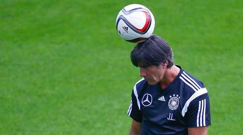 Joachim Loew, coach of the German national soccer team arrives on the pitch for a training session of the German squad in Frankfurt, Germany, September 3, 2015. Germany will play a Euro 2016 qualification match against Poland in Frankfurt on Friday.     REUTERS/Kai Pfaffenbach