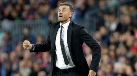 Barcelona's head coach Luis Enrique reacts during a Champions League Group E soccer match between Barcelona and Bayer Leverkusen at Camp Nou stadium in Barcelona, Spain, Tuesday, Sept. 29, 2015. (AP Photo/Emilio Morenatti)