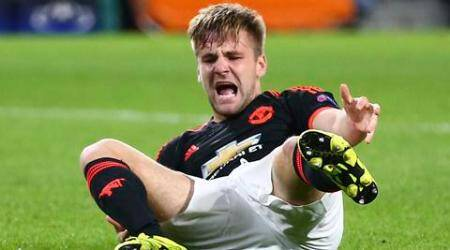 Manchester United's Luke Shaw grimaces in pain after being tackled by PSV's Hector Moreno, resulting in a double fracture of Shaw's right leg, during the Champions League Group B soccer match between PSV and Manchester United at Philips stadium in Eindhoven, Netherlands, Tuesday, Sept. 15, 2015. (AP Photo/Peter Dejong)
