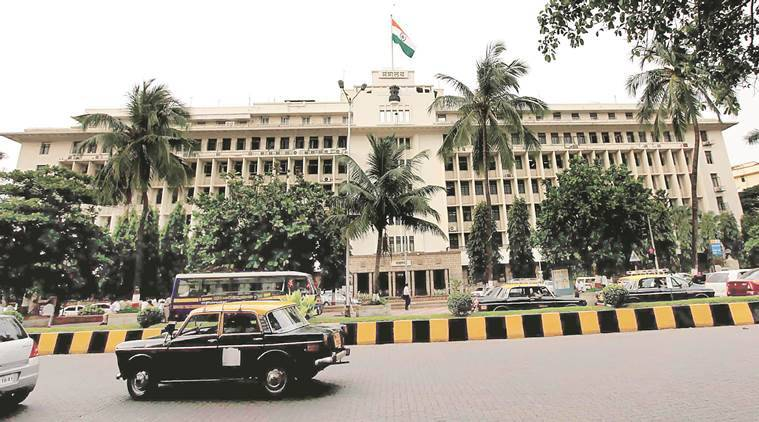 MNS workers dig up pavement outside Mantralaya in protest against potholes
