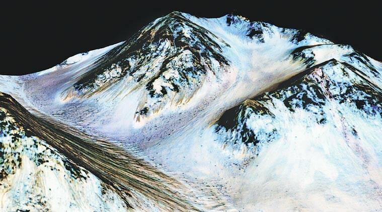"""Dark, narrow streaks on Martian slopes such as these at Hale Crater are inferred to be formed by seasonal flow of water on contemporary Mars. The streaks, called """"recurring slope lineae"""" or RSL, are roughly the length of a football field. The imaging and topographical information in this processed, false-colour view come from the High Resolution Imaging Science Experiment (HiRISE) camera on NASA's Mars Reconnaissance Orbiter. (Source: NASA)"""