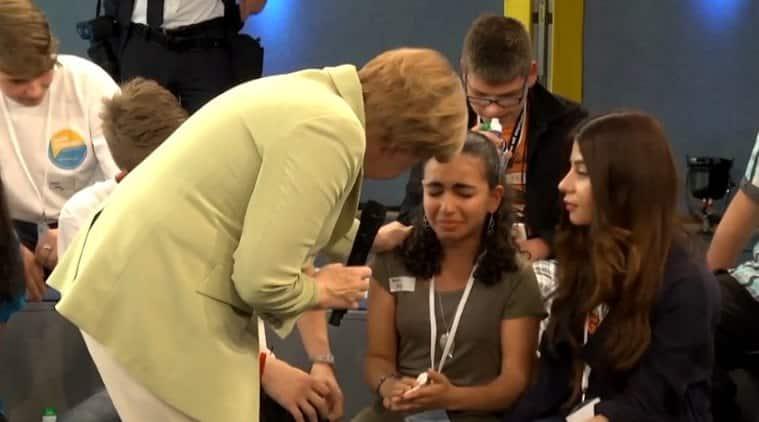 angela merkel, merkel refugee girl crying, merkel refugee crying video, Palestine girl crying Merkel, europe migrant crisis, migrant crisis, europe news, world news, latest world news