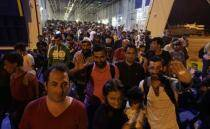 Hungary stops migrants from boarding westbound trains; smugglers wait in wings