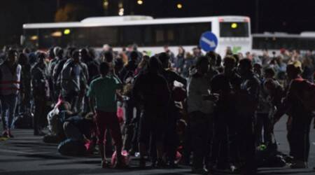 Migrants surge into Western Europe throughAustria