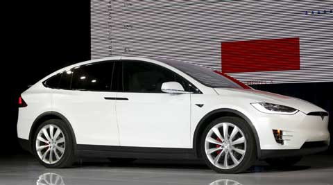 Tesla launches Model X electric SUV to take on luxury carmakers