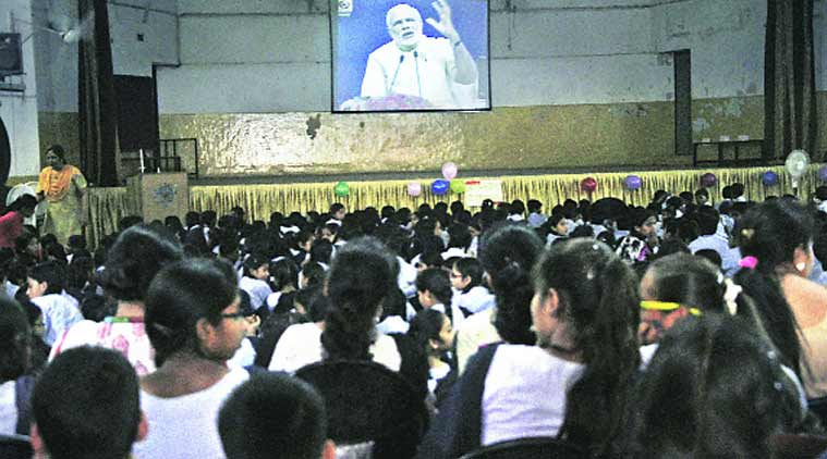 Students listen to Prime Minister Narendra Modi's address, at Government Model School in Sector 10, Chandigarh, on Friday; Photo: Sahil Walia, Kamleshwar Singh