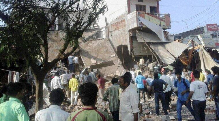 Jhabua : Crowds near a collapsed restaurant where a cooking gas cylinder exploded in Petlawad town in Jhabua district of Madhya Pradesh on Saturday. (Source: PTI)
