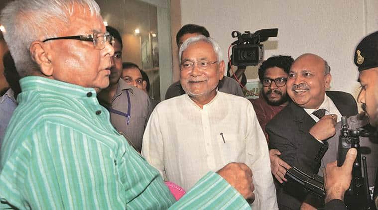 Nitish Kumar with Lalu Prasad at an event in Patna Tuesday. (PTI Photo)