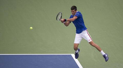 US Open 2015: Novak Djokovic romps into second round with win in straight sets