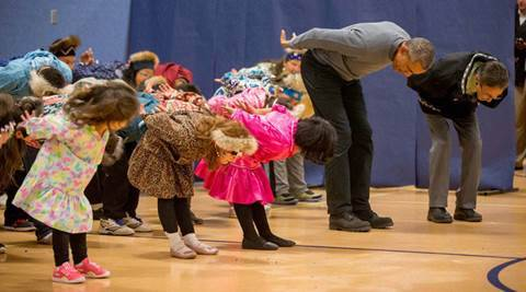 Dillingham : President Barack Obama participates in a performance by native Alaskan dancers at Dillingham Middle School, Wednesday, Sept. 2, 2015, in Dillingham, Alaska. Obama is on a historic three-day trip to Alaska aimed at showing solidarity with a state often overlooked by Washington, while using its glorious but changing landscape as an urgent call to action on climate change.  AP/PTI(AP9_3_2015_000163B)
