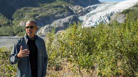 In climate bid, Obama stares down melting Alaska glacier