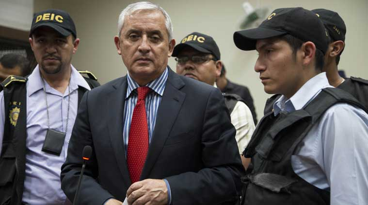 Former President of Guatemala Otto Perez Molina, center, speaks to reporters after a court hearing where he faces corruption charges, in Guatemala City. (Source: AP)