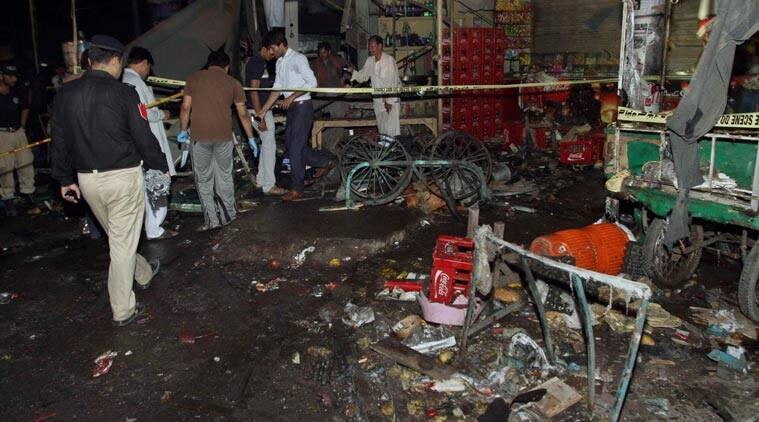 Pakistani police and security officers examine the site of an explosion in Multan, Pakistan, Sunday, Sept. 13, 2015. A police official said the blast outside of a bus terminal in central Pakistan killed several people and wounded tens. (Source: AP)