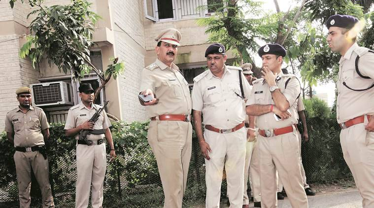 Policemen investigate after a cashier of UHBVN was shot dead by four robbers who made away with Rs 9.5 lakh that he was carrying, in Panchkula. (Express Photo)