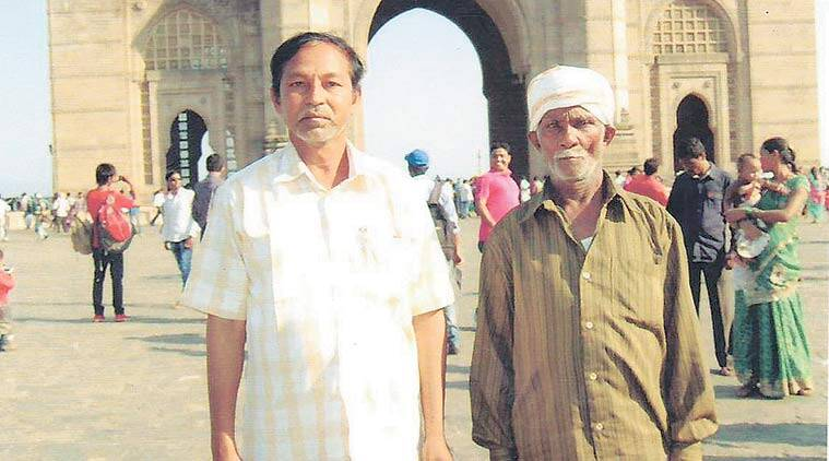Patru Durge (left) with a fellow villager in Mumbai in February 2015, two months before he was killed by Naxals.