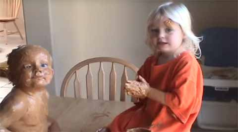 Video: Little girl covers brother in peanut butter, pretends it's all cool