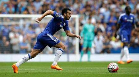 Making his home debut Chelsea's new player Pedro runs with the ball during the English Premier League soccer match between Chelsea and Crystal Palace at Stamford Bridge stadium in London, Saturday, Aug. 29, 2015.  (AP Photo/Matt Dunham)