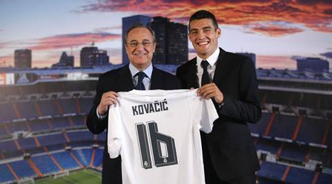 Real Madrid's new soccer player Mateo Kovacic, right, poses with club President Florentino Perez during his official presentation to the media at the Santiago Bernabeu stadium in Madrid, Spain, Wednesday, Aug. 19, 2015. Kovacic, who played before in Italian Inter Milan team, has signed a contract for six seasons. (AP Photo/Francisco Seco)