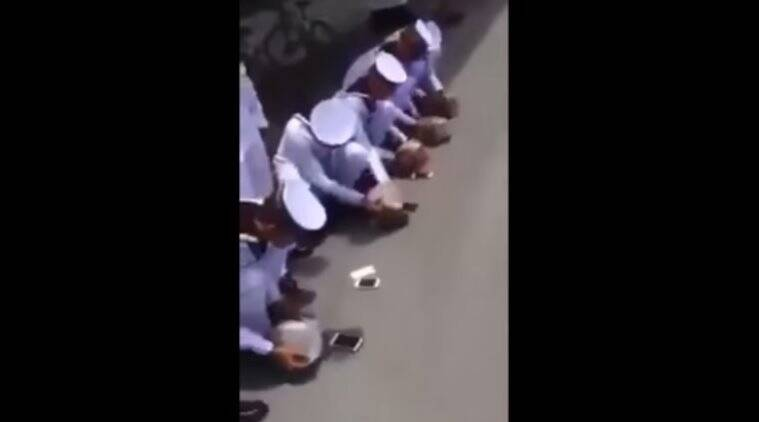 A screengrab from the video shows Thai cadets smashing their phones.