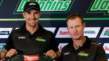 Cricket player Kevin Pietersen, left, poses with  Lance Klusener, right, during his official presentation to the media after signing a short-term contract to play Twenty20 cricket at OR Tambo International Airport in Johannesburg, South Africa, Tuesday, Sept. 8, 2015. Pietersen will be available for five games for the Durban-based Dolphins from the start of November, returning to the team he started at but then left as a youngster to pursue a career in England. (AP Photo/Themba Hadebe)