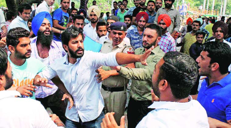 Scuffle between SOI and NSUI leaders at Students' Centre at PU, Chandigarh, on Thursday.  Express